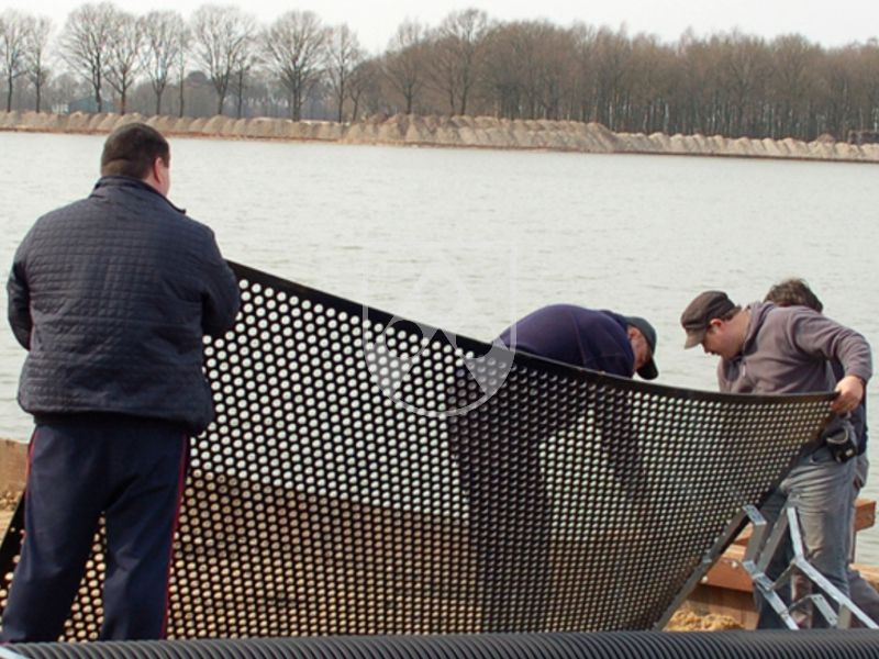 Perforated plastic sheets made of Polystone® G black for the separation of pond zones